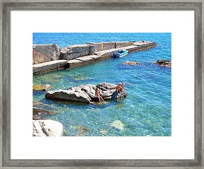 Children Fascinated With Black Sea  Framed Print by Rick Todaro
