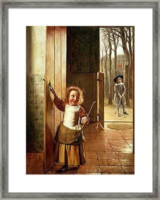 Children In A Doorway With Golf Sticks Framed Print by Pieter de Hooch