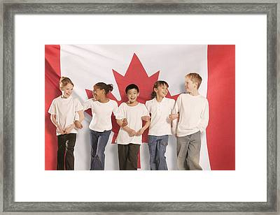 Children In Front Of Canadian Flag Framed Print by Don Hammond