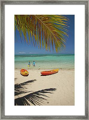 Children, Kayaks And Palm Frond Framed Print