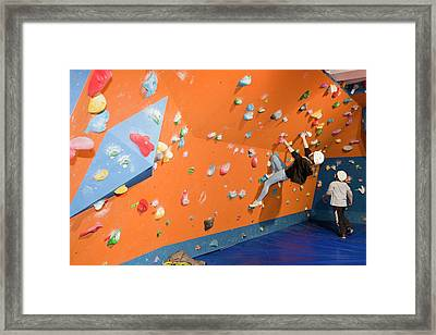Children On A Climbing Wall Framed Print by Ashley Cooper