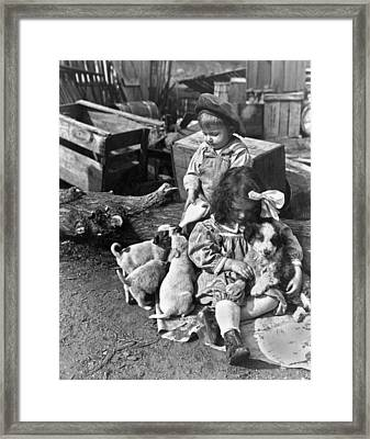 Children On Farm With Puppies Framed Print by Underwood Archives