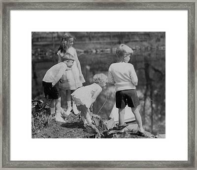 Children Playing Beside A Pond Framed Print