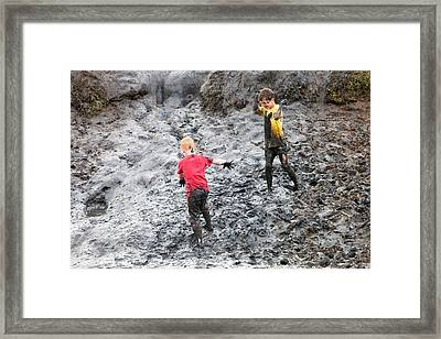 Children Playing In A Muddy Creek Framed Print