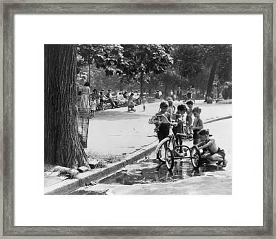 Children Playing In Park Framed Print