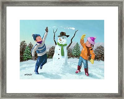 Children Playing In Snow Framed Print by Martin Davey
