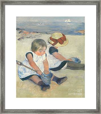 Children Playing On The Beach Framed Print