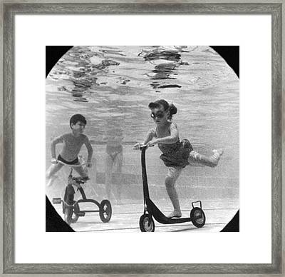 Children Playing Under Water Framed Print by Underwood Archives