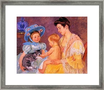 Children Playing With A Cat Framed Print by Marry Cassatt