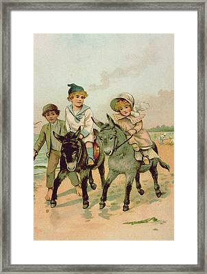 Children Riding Donkeys At The Seaside Framed Print by Harriet M Bennett