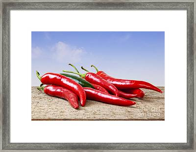 Chilli Peppers On Rustic Background Framed Print