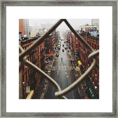 Chinatown Seen Through Fence On A Foggy Framed Print by Alexander Spatari