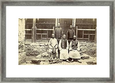 Chinese Men And A Boy Near A House In Tibet Framed Print by Artokoloro