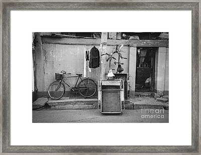 Chinese Still Life With Bicycles And Laundry Framed Print