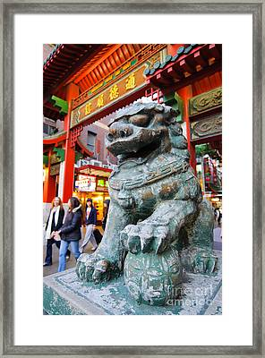 Chinese Stone Lion Protects The Chinatown Gate Framed Print by David Hill