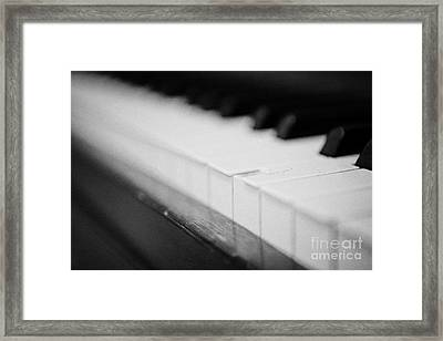 Chipped Key On A Baby Grand Piano In A Music Training Room Framed Print by Joe Fox