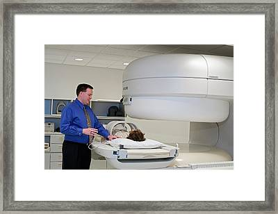 Chiropractor With Patient And Mri Scanner Framed Print