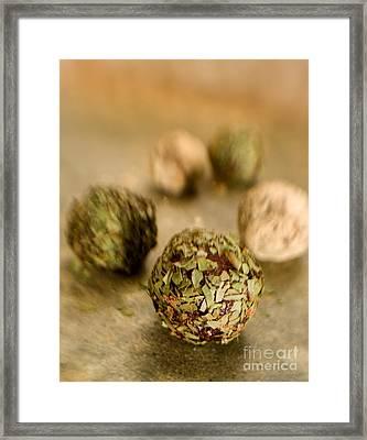 Chocolate Truffles On Golden Green Framed Print by Iris Richardson