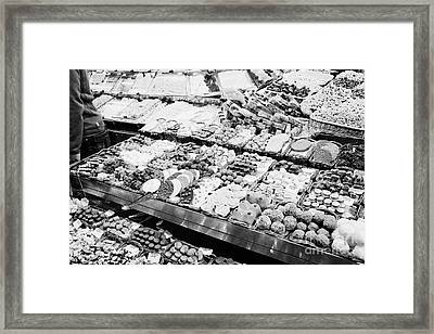 chocolates on display inside the la boqueria market in Barcelona Catalonia Spain Framed Print by Joe Fox