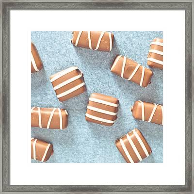 Chocolates Framed Print by Tom Gowanlock
