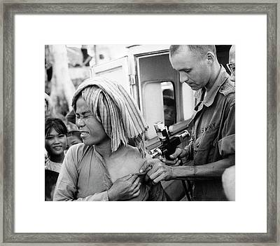 Cholera Vaccination In Vietnam Framed Print by Us National Archives