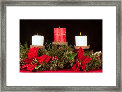 Christmas Candle Trio Framed Print by Kenneth Sponsler