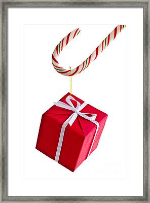 Christmas Candy Cane And Present Framed Print by Elena Elisseeva