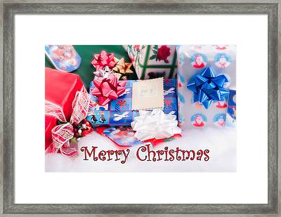 Framed Print featuring the photograph Christmas Presents On Artificial Snow by Vizual Studio