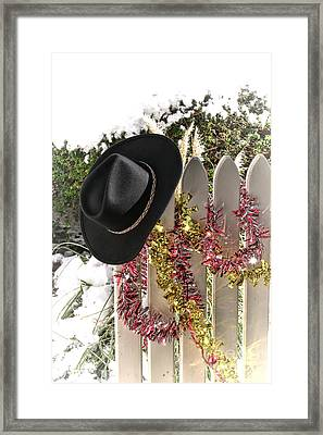 Christmas Cowboy Hat On A Fence Framed Print