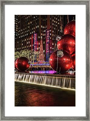 Christmas Decorations Near Radio City Framed Print by F. M. Kearney