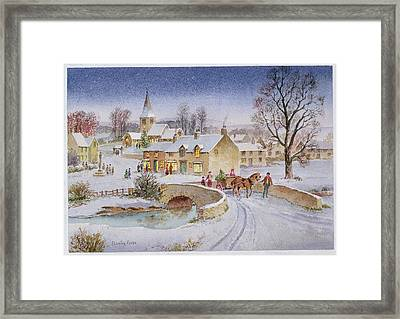 Christmas Eve In The Village  Framed Print by Stanley Cooke