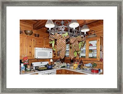 Christmas Kitchen Framed Print by Susan Leggett
