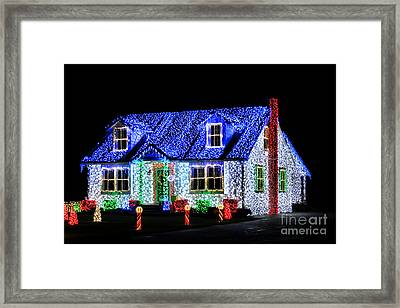 Christmas Lighthouse Framed Print by Olivier Le Queinec