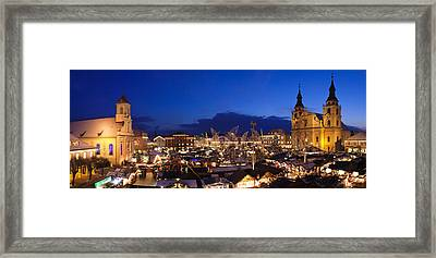 Christmas Market Lit Up At Night Framed Print by Panoramic Images