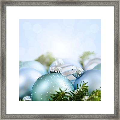 Christmas Ornaments On Blue Framed Print by Elena Elisseeva