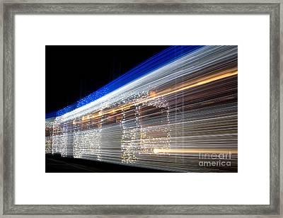 Christmas Tram Framed Print by Eszter Kovacs