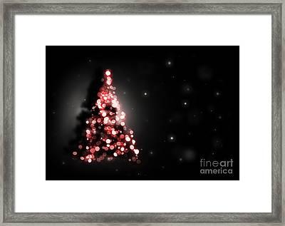 Christmas Tree Shining On Black Background Framed Print