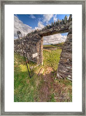Church Gate Framed Print by Adrian Evans