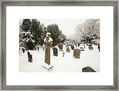 Church Yard In Snow Framed Print by Ashley Cooper