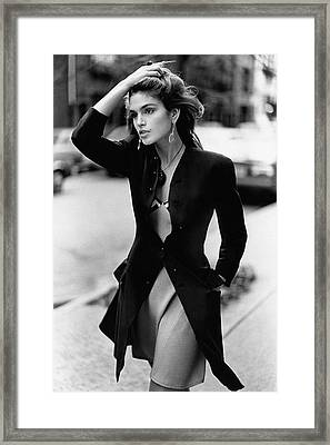 Cindy Crawford Wearing A Wool Coat Over A Slip Framed Print by Arthur Elgort