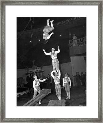Circus Acrobats Practicing Framed Print by Underwood Archives
