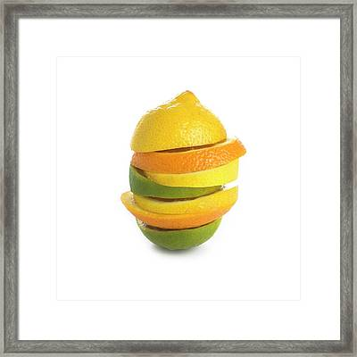 Citrus Fruit Slices In A Stack Framed Print by Science Photo Library