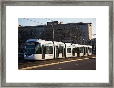 City Centre Tram Framed Print by Andrew Wheeler