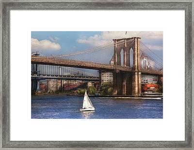 City - Ny - Sailing Under The Brooklyn Bridge Framed Print by Mike Savad