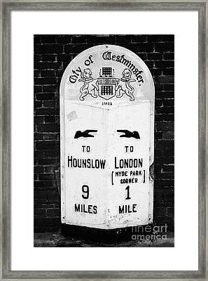 city of westminster old metal milestone between london and hounslow London England UK Framed Print