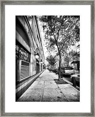 City Street Framed Print by John Rizzuto
