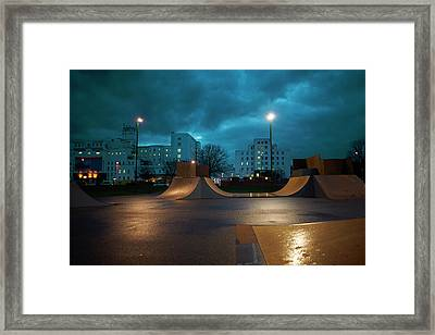 Cityscape And Skateboard Park At Night Framed Print by Peter Muller