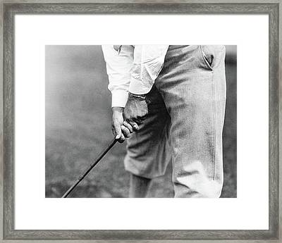 Clarence W. Gamber Holding A Golf Club Framed Print by Artist Unknown
