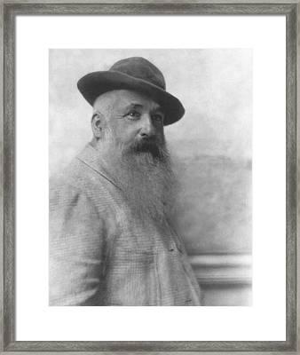 Claude Monet Wearing A Hat Framed Print by Adolphe De Meyer