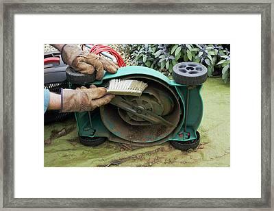 Cleaning A Lawnmower Framed Print by Geoff Kidd